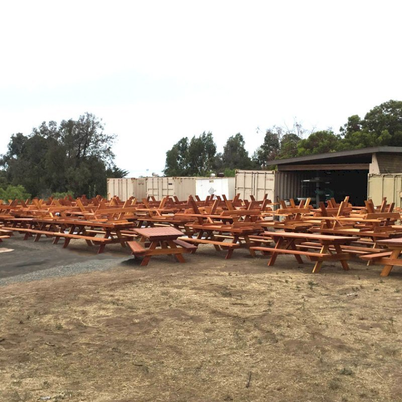 Photo Courtesy of El Capitan State Beach in Goleta, CA. Shows over 30 8' table sets as part of 130 table installation in progress in July 2015.