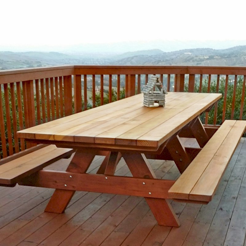 "Forever Picnic Table (Options: 12' L, 40 1/4"" W, Attached Side Benches, California Redwood, Standard Tabletop, Slightly Rounded Corners, 2"" Umbrella Hole, Transparent Premium Sealant). Photo Courtesy of J. Calzetta of Salinas, CA."