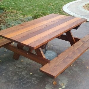 "Forever Picnic Table (Options: 6' L, 40 1/4"" W, Attached Side Benches, Old-Growth Redwood, Standard Tabletop, Slightly Rounded Corners, 1 5/8"" Umbrella Hole, Transparent Premium Sealant). Photo Courtesy of T. Atkinson of Fort Collins, CO."