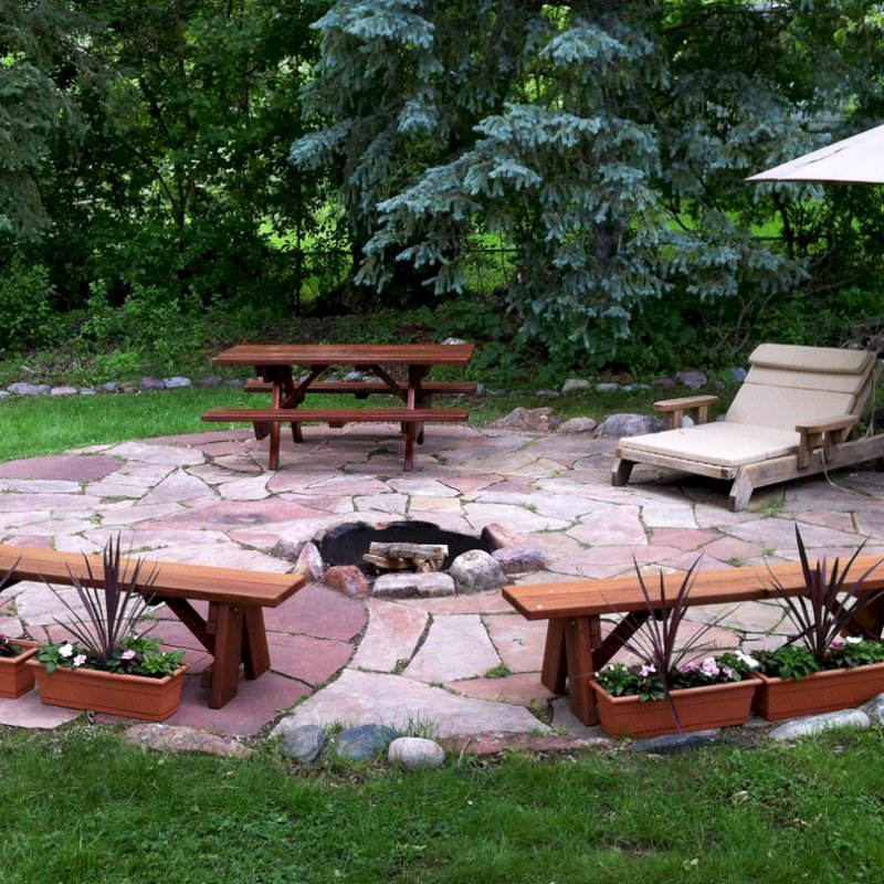 "Forever Picnic Table (Options: 6' L, 34 1/2"" W, Side Benches, Old-Growth Redwood, Standard Tabletop, Rounded Corners, Umbrella Hole, Transparent Premium Sealant). Photo Courtesy of M. Wolf of Golden Valley, Minnesota."
