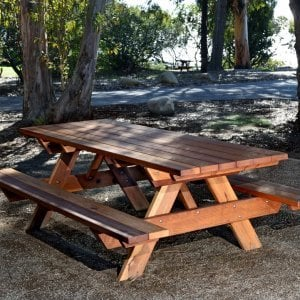 "Forever Picnic Table (Options: 8' L, 34 1/2"" W, Side Benches, Redwood, Standard Tabletop, Slightly Rounded Corners, No Umbrella Hole, Transparent Premium Sealant). Located at El Capitan State Beach near Santa Barbara, CA part of a 90 table installation completed in 2015."