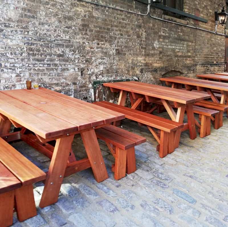 """Custom Forever Picnic Tables (Options: 5' L, 34 1/2"""" W, Old-Growth Redwood, 1 Full Length Bench Per Side, Custom Tabletop (with the Book End Work to Make 2 Boards Look Like One 11 1/2"""" Wide Board), Square Corners, 2"""" Umbrella Hole, Table with an Extra Brace Underneath to Hold the Umbrella Stand, Transparent Premium). Photo Courtesy of A. Koval of Chicago, Illinois."""