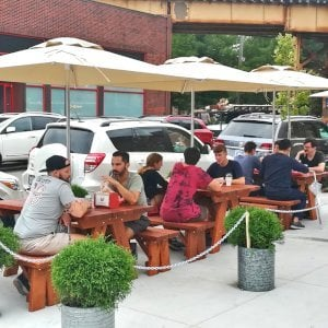 """Custom Forever Picnic Tables (Options: 5' L, 34 1/2"""" W, Old-Growth Redwood, 1 Full Length Bench Per Side, Standard Tabletop, Slightly Rounded Corners, Umbrella Hole, Table with an Extra Brace Underneath to Hold the Umbrella Stand, Transparent Premium). Photo Courtesy of A. Peterson of Chicago, Illinois."""