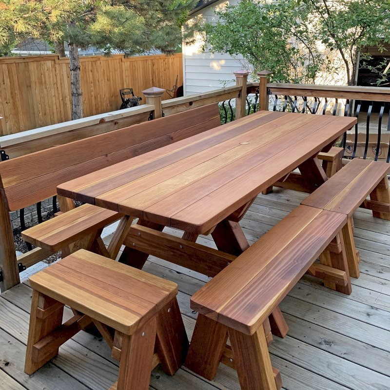 """Forever Picnic Table  (Options: 7' L, 34 ½"""" W, Side and End Benches, California Redwood, 1 Full Length Fullback Bench on One Side, and 2 Half Length Picnic Benches on the Other Side, Standard Tabletop, Squared Corners, 2"""" Diameter Umbrella Hole, Transparent Premium Sealant). Photo Courtesy of I. Miller of Longmont, Colorado."""