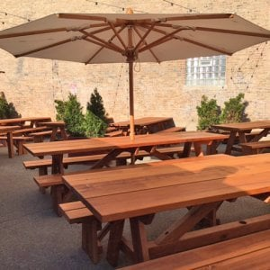 "Custom Forever Picnic Tables (Options: 10' L, 34 ½"" W, Old-Growth, 2 Full Length Side Benches, Standard Tabletop, Squared Corners, 2 1/2"" Umbrella Hole, Standard Leg Flair, Transparent Premium). Using Two Tongue & Groove Matching 5 3/4"" Boards to Create the Appearance of an 11 1/2"" Wide Board Construction. Photo courtesy of Small Cheval Restaurant, 1732 N Milwaukee Ave, Chicago, IL 60647."