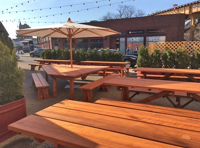 "Custom Forever Picnic Tables (Options: 10' L, 34 ½"" W, Old-Growth, 2 Full Length Side Benches, Standard Tabletop, Squared Corners, 2 1/2"" Umbrella Hole, Standard Leg Flair, Transparent Premium). Using Two Tongue & Groove Matching 5 3/4"" Boards to Create the Appearance of an 11 1/2"" Wide Board Construction. Photo Also Shows a Custom Triangular Picnic Table Set. Photo courtesy of Small Cheval Restaurant, 1732 N Milwaukee Ave, Chicago, IL 60647."