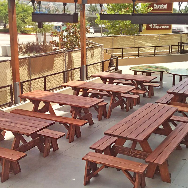 "Forever Picnic Table (Options: 7' L, 28 3/4"" W, Side & End Benches [Tables on the left with no end benches], Douglas-fir, 1 Full Length Side Benches Per Side, Standard Tabletop, Slightly Rounded Corners, No Umbrella Hole, Coffee- Stain Premium Sealant). Photo Courtesy of D. Peters of San Diego, CA."