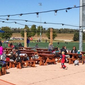 "Forever Picnic Tables (Options: 8' & 5' L, 28 3/4"" W, Side Benches, Old-Growth Redwood, 1 Full Length Side Bench Per Side, Standard Tabletop, Squared Corners, No Umbrella Hole, Transparent Premium Sealant). Photo Courtesy of Sportport International of Maryland Heights, Missouri."