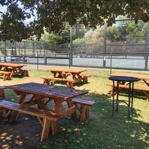 "Forever Picnic Tables (Options: 6' L, 34 ½"" W, Side Benches, Redwood, 1 Full Length Side Bench Per Side, Standard Tabletop, Squared Corners, No Umbrella Hole, Transparent Premium Sealant). Photo Courtesy of The Knowlwood Tennis Club of Santa Barbara, CA"