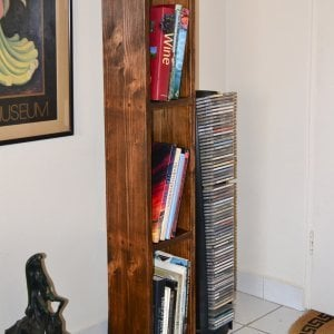 "Greg's Bookcase (Options: 60""H x 12""W x 8""D, Douglas-fir, 4 Shelves, Open Back, Coffee-Stain Premium Sealant)."