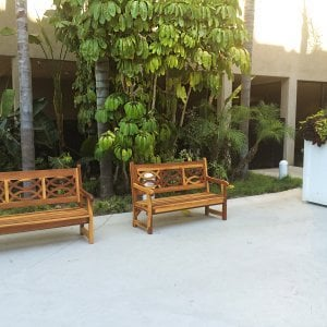 Hennel Benches (Options: 5 ft, California Redwood, No Cushion, No Engraving, Transparent Premium Sealant). Photo Courtesy of Knott's Berry Farm in Buena Park, CA. You can see these benches in the courtyard of the Knott's hotel in Buena Park.