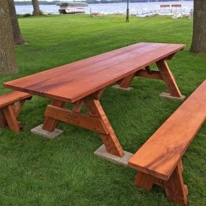 "Heritage Picnic Table (Options: 10' L, 34 1/2"" W, Side Benches, Unattached Benches, 1 Full Length Side Bench/Side, Standard Tabletop, Squared Corners, No Umbrella Hole, Transparent Premium Sealant). Engraving by Custom Request. Photo Courtesy of A. Perdue of Stoughton, WI."