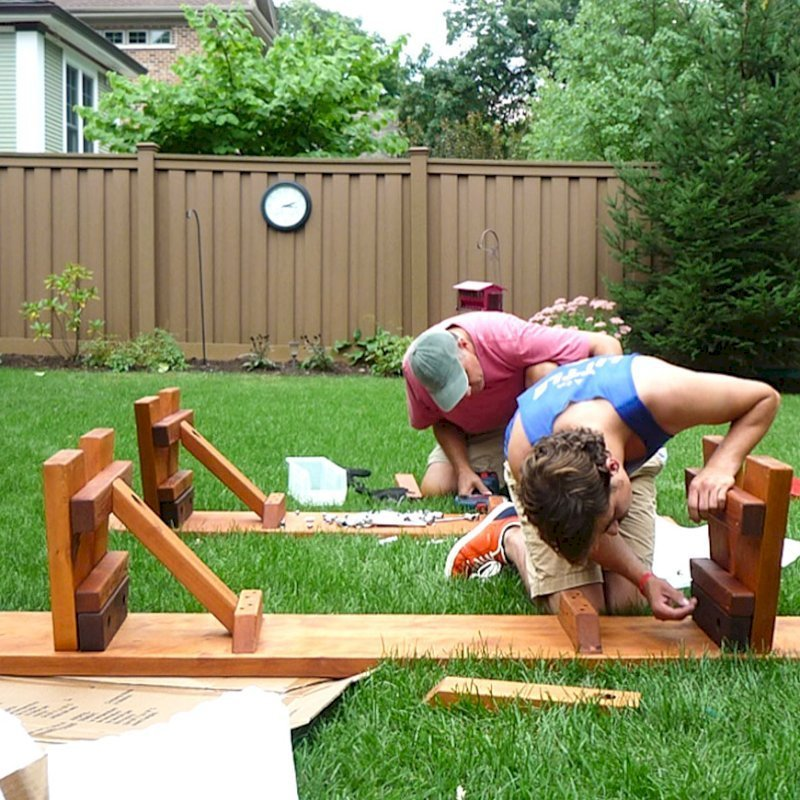 """Assembly of a Heritage Picnic Table (Options: 12' L, 34 1/2"""" W, Side Benches, 2 Half Length Side Benches/Side, Classic Forever Benches, Standard Tabletop, Slightly Rounded Corners, Standard Leg Flair, No Umbrella Hole, Transparent Premium Sealant). Photo Courtesy of Pat Meyer of River Forest, Illinois."""