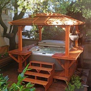 Custom Hot Tub Pavilion (Options: 10' x 10', California Redwood, No Windows, Custom Bar on 3 Sides, 7.5' x 7.5' Custom Skylight, No Anchors, Transparent Premium Sealant). Photo Courtesy of D. Rand of San Francisco, CA.
