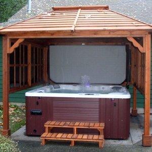 Hot Tub Pavilion (Options: 9' x 9', Redwood, Windows on 3 Sides, No Curtain Rods, 4-Post Anchor Kit for Stone, Transparent Premium Sealant). Photo Courtesy of John Grubb.