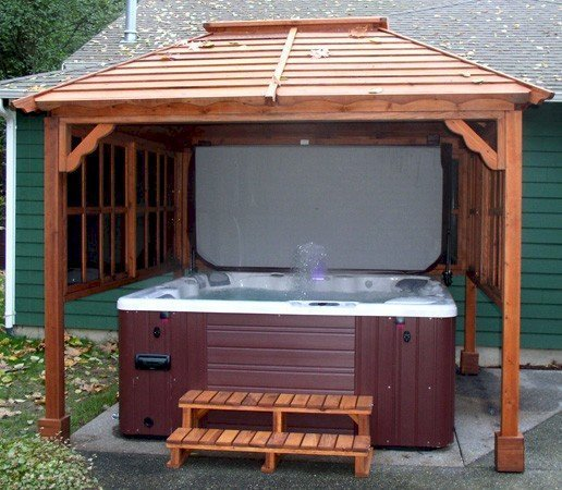 Hot Tub Pavilion (Options: 9' x 9', California Redwood, Windows on 3 Sides, No Curtain Rods, 4-Post Anchor Kit for Stone, Transparent Premium Sealant). Photo Courtesy of John Grubb.