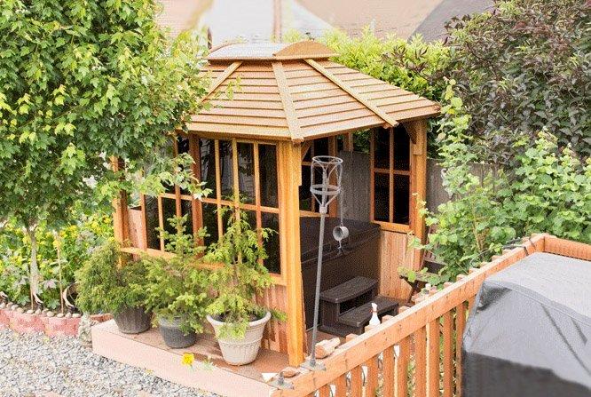 Hot Tub Pavilion (Options: 8' x 8', California Redwood, Windows on 3 Sides, Transparent Premium Sealant). Photo Courtesy of Mark L. of Everett, Washington. Note: Custom wall construction per customer request.