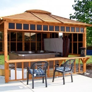 Hot Tub Pavilion (Options: 10' x 10', Redwood, Windows on 2 Sides, No Curtain Rods,4-Post Anchor Kit for Stone, Transparent Premium Sealant). Window Bar is a Custom Request. Photo Courtesy of Sherry L. of Smithton, IL.