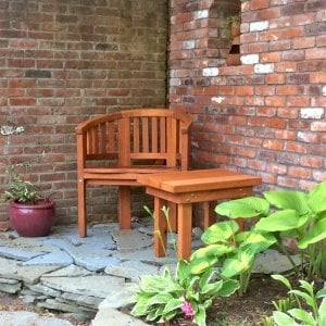 Jane's Key West Chair (Options: Mature Redwood, No Cushion, No Engraving, Transparent Premium Sealant). Photo Also Shows a Rectangular Side Table. Photo Courtesy of Tom. James T. Dewing of Orleans, Massachusetts.