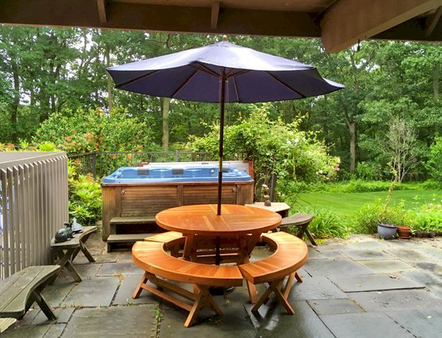 """Karyn's Folding Picnic Table (Options: Douglas-fir, 3 Arc Folding Benches, Standard Tabletop, Checkerboard Design Tabletop, 1 5/8"""" Umbrella Hole, Transparent Premium Sealant). Photo Courtesy of A. McCauley of Guilford, Connecticut."""