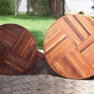 "SIZE AND TABLETOP COMPARISON: Round Folding Table - Left: 42"" in Old-Growth Redwood with Standard Tabletop Spacing, Karyn's Folding Table: Mature Redwood with the Seamless Tabletop Spacing."