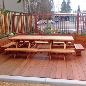 Custom Kid's Picnic Table (Options: Redwood, No Umbrella, Standard Top, Custom End Bench, Transparent Premium Sealant). Custom set for School. Was designed to easily use as one large gathering point or separate as two. Photo Courtesy of T. Becker of San Jose, CA.