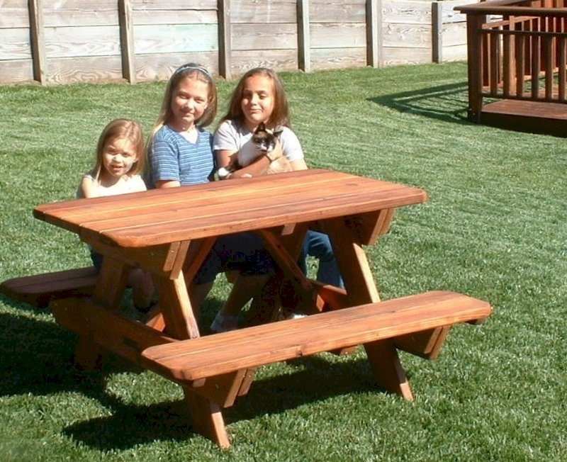 Kid's Picnic Table (Options: Mature Redwood, No Umbrella, Standard Top, Transparent Premium Sealant). Custom design: rounded corners and thickness of the bars of the table are thinner than standard. Photo Courtesy of Rachel & Tim McAllister of Santa Rosa, CA.