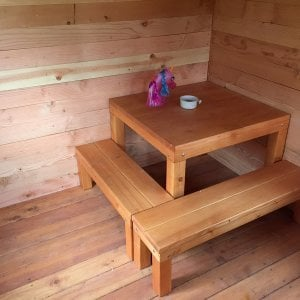 Kid's Backyard Cabin (Options: 12ft L x 8ft W, 7ft Wall H, Oldgrowth, 4ft Front Porch Size (are included in the full Cabin Length), Interior Decking, Transparent Premium Sealant). Note: Table and benches were a custom request. If you would like furnishings for your Cabin, just let us know!
