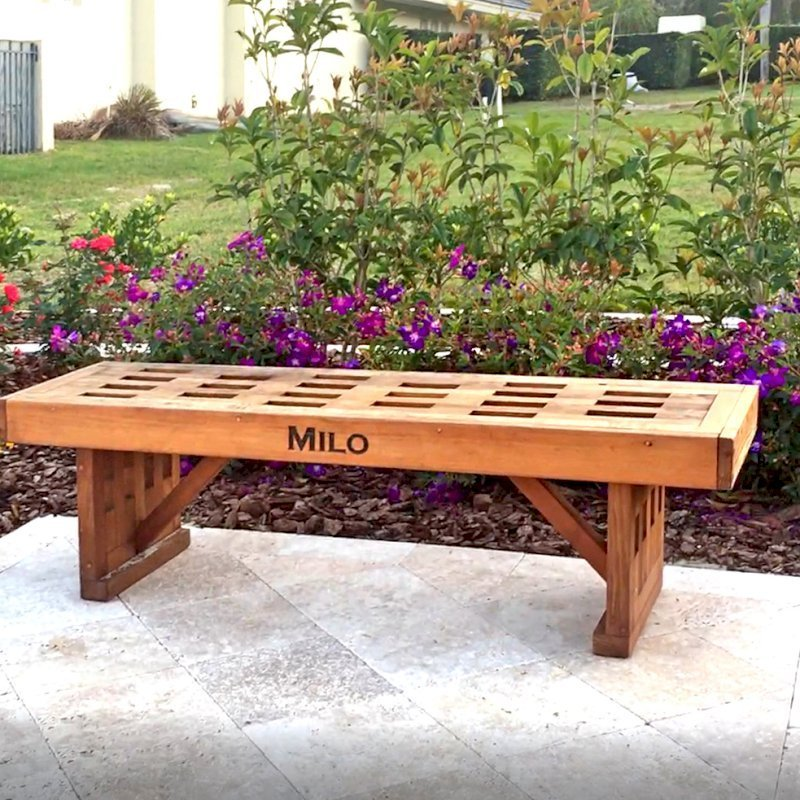 Lighthouse Garden Bench (Options: 5 ft L x 17 3/4 inches W x 17 inches H, Mature Redwood, No Cushion, Custom Engraving, Transparent Premium Sealant). Photo Courtesy of S. Porcaro of Windermere, Florida.