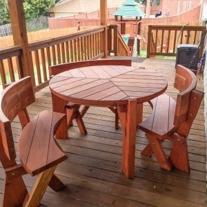 "Lisa's Dining Table (Options: 4' Diameter, Redwood, Fullback Arc Benches, Standard Tabletop, No Lazy Susan, 2"" Umbrella Hole, Transparent Premium Sealant). Photo Courtesy of Mr. and Ms. Tillery of Garland, TX."