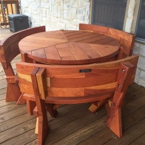"Lisa's Dining Table (Options: 4' Diameter, Fullback Arc Benches, Redwood, Standard Tabletop, No Lazy Susan, 2"" Umbrella Hole, Transparent Premium Sealant). Photo Courtesy of Mr. and Ms. Tillery of Garland, TX."