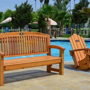 Luna Memorial Bench (Options: 5 ft, Douglas-fir, No Cushion, No Engraving, Custom Plaque Provided by Customer, Transparent Premium Sealant). Photo also shows an Adirondack Rocking Chair.