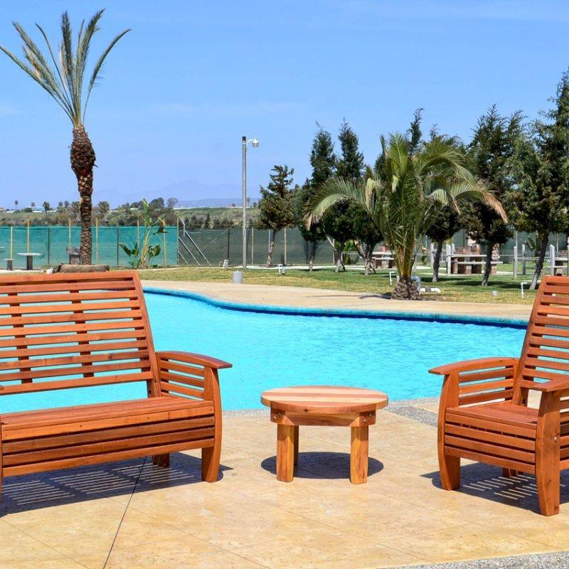 Marazul Chair (Options: Mature Redwood, No Cushion, Transparent Premium Sealant), Marazul Loveseat and Ashley Round Side Table.