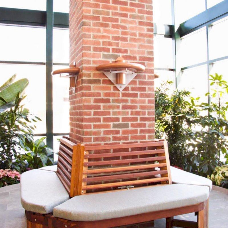 Maria's Tree Bench (Options: 6 1/2', California Redwood, No Beverage Ledge, Add Custom Cushion, No Engraving, Transparent Premium Sealant). Photo Courtesy of ECHN Hospital, Manchester CT 06040.
