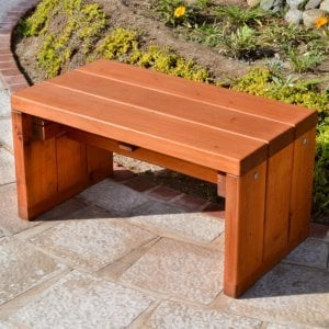 Maynard Garden Bench (Options: 2 1/2 ft x 16 inches W x 15 1/2 inches H, Mature Redwood, No Cushion, No Engraving, Transparent Premium Sealant). Photo Courtesy of The Estero Beach Resort of Ensenada, Mexico.