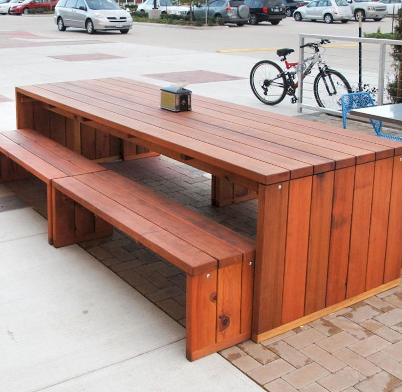 "Maynard Table (Options: 10' L, 40 1/4"" W Tabletop, Side Benches, Redwood, 2 Half Length Maynard Benches Per Side, Standard Tabletop, No Umbrella Hole, Transparent Sealant). Photo courtesy of Whole Foods Mkt, 6601 South Fry Rd. Katy, Texas."