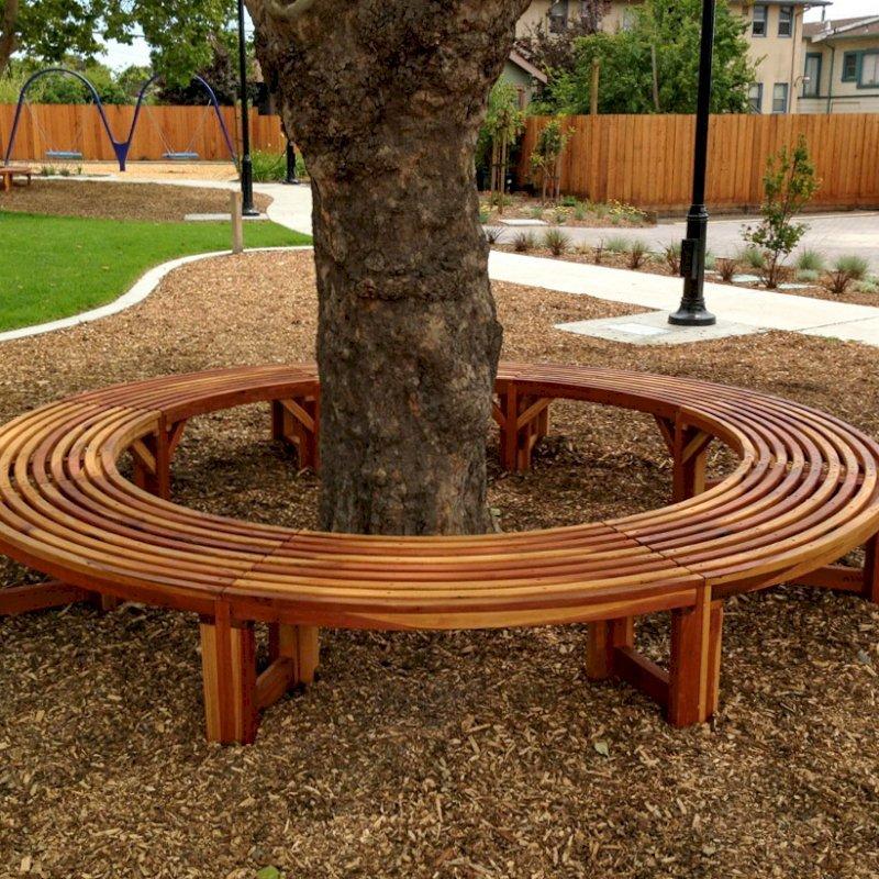 The Miramar Custom Tree Bench (Options: 10 1/2 ft [Full Circle by Custom Request], California Redwood, Transparent Premium Sealant). Photo Courtesy of Pogo Park of Richmond, CA (www.pogopark.org).