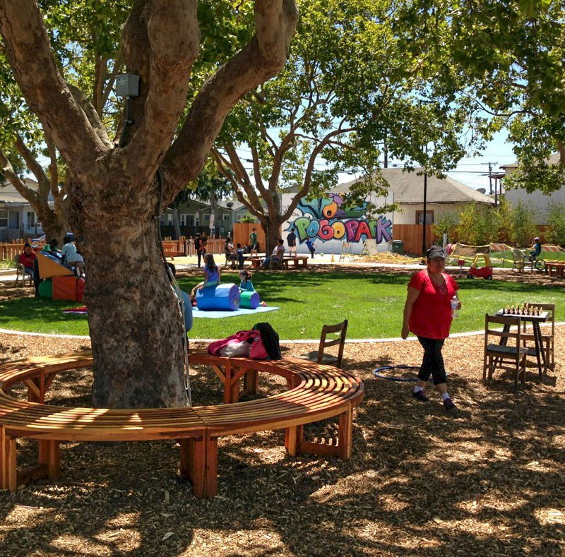 The Miramar Custom Tree Bench (Options: 10 1/2 ft [full circle by custom request], Redwood, Transparent Premium Sealant). Photo Courtesy of Pogo Park of Richmond, CA (www.pogopark.org).