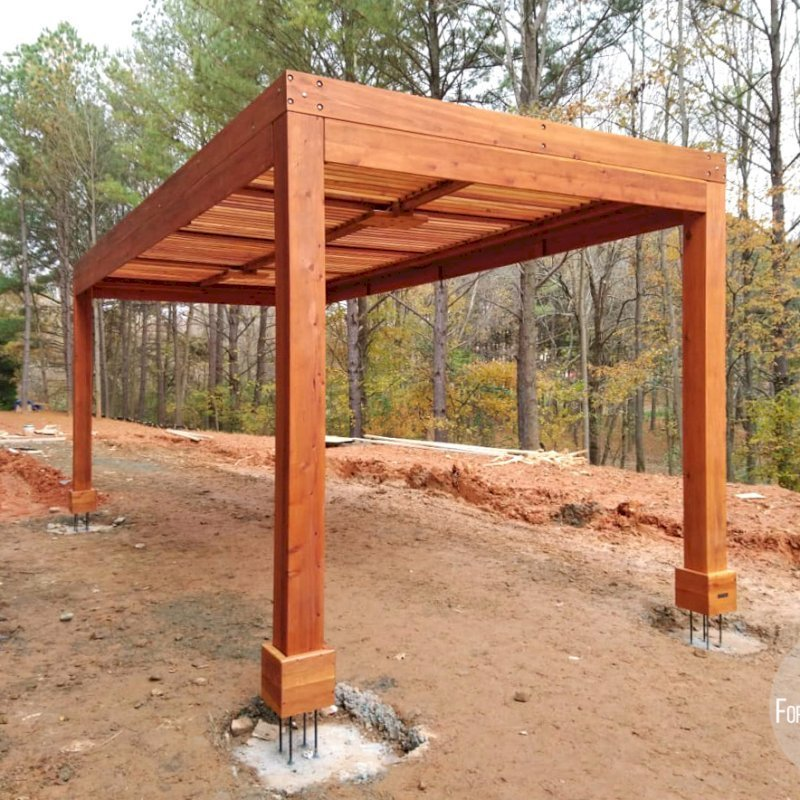 """Modern Louvered Garden Pergola (Options: 22' L x 10' W, 8"""" x 8"""" Posts, Mobile Louvers, California Redwood, 9.5 ft H, No Electrical Wiring Trim, 4 Post Anchor Kit for Gale-Wind, No post decorative trims, No Ceiling Fan Base, Transparent Premium Sealant). The pergola is """"up in the air"""" so that the final hardscape can be poured over the footings so that there is no joint showing and the final hardscape will be seamless. Photo Courtesy of M. Graff of Atlanta, Georgia."""