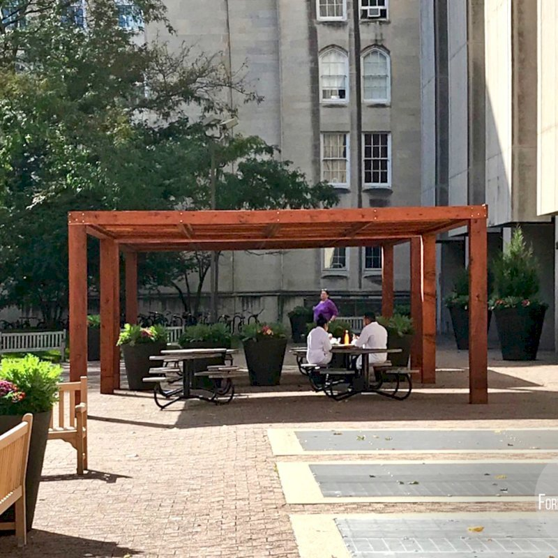 """Modern Louvered Garden Pergolas (Options: 20' L x 20' W, 10"""" x 10"""" Posts [Anchor System for 8X8 Posts with Trim Pieces Flush for 10X10 Posts], Fixed, California Redwood, 9 ft H, No Electrical Wiring Trims, 4 Post Anchor Kit for Concrete, No Post Decorative Trims, No Ceiling Fan Base, Transparent Premium Sealant). Photo Courtesy of the University of Chicago."""