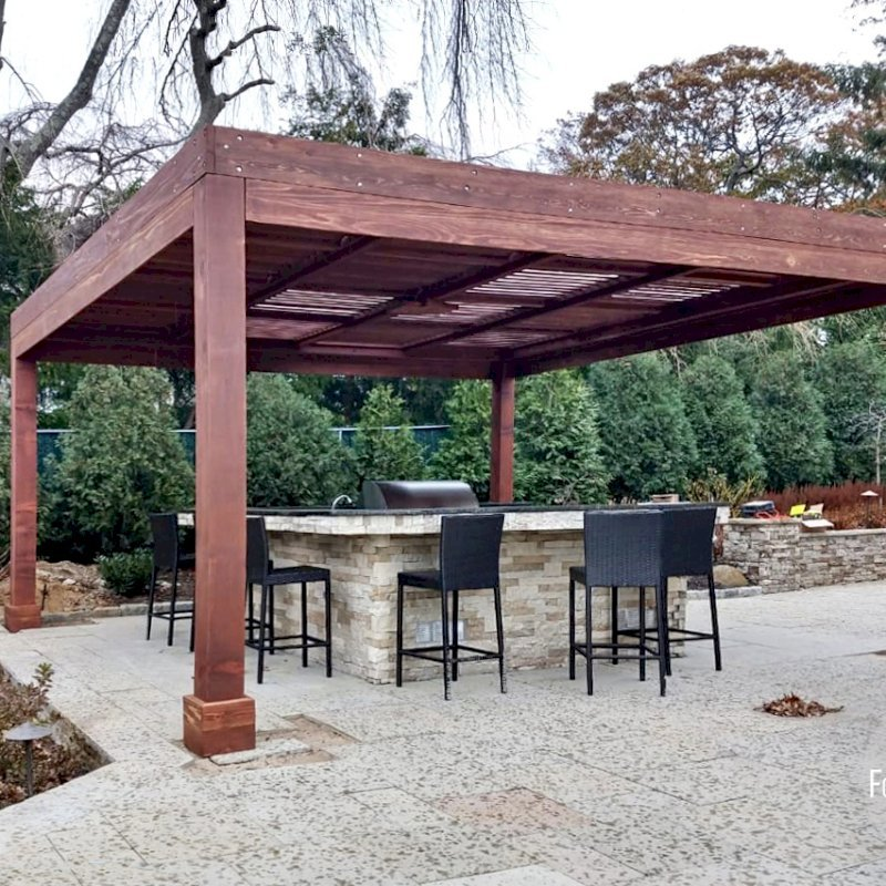 """Modern Louvered Garden Pergola (Options: 18' L x 18' W, 8"""" x 8"""" Posts, Mobile Louvers, California Redwood, 10 ft H, 1 Electrical Wiring Trim, No Curtain Rods, 4 Post Anchor Kit for Concrete, No Post Decorative Trims, 1 Ceiling Fan Base, Coffee-Stain Premium Sealant). Photo Courtesy of C. Passmore of Lawrence, New York."""