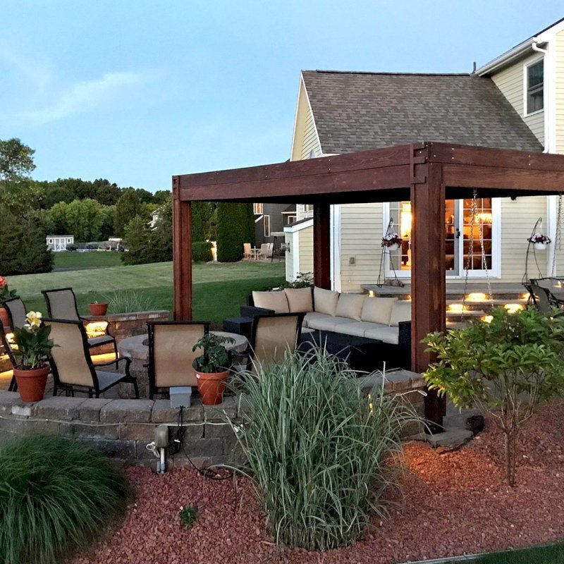 """Modern Louvered Garden Pergola (Options: 10' L x 18' W, 8"""" x 8"""" Posts, Mobile Louvers, Mature Redwood, 9 ft H, 2 Electrical Wiring Trims, 4 Post Anchor Kit for Concrete, Custom Vertical Post Decorative Trims, No Ceiling Fan Base, Coffee-Stain Premium Sealant). Photo Courtesy of D. Gauthier of Liverpool, NY."""
