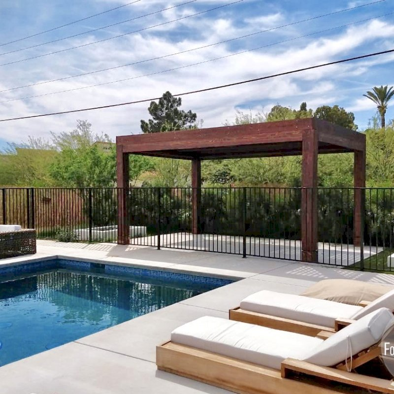 """Modern Louvered Garden Pergola (Options: 18' L x 12' W, 10"""" x 10"""" Posts, Mobile Louvers, California Redwood, 9.5 ft H, 1 Electrical Wiring Trim, 2 Curtain Rods, 4 Post Anchor Kit for Concrete, No post decorative trims, 1 Ceiling Fan Base, Coffee-Stain Premium Sealant). Photo Courtesy of G. Hewson of Phoenix, Arizona."""