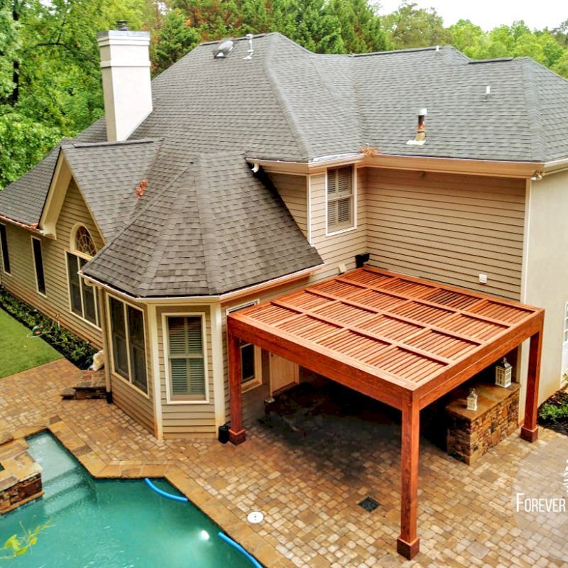 """Modern Louvered Garden Pergola (Options: 15' L x 15' W, 8"""" x 8"""" Posts, Mobile Louvers, Douglas-fir, 9 ft H, 1 Electrical Wiring Trim, 2 Curtain Rods, 4 Post Anchor Kit for Concrete, No Post Decorative Trims, 1 Ceiling Fan Base, Coffee-Stain Premium Sealant). Photo Courtesy of J. Mcknight of Smyrna, Georgia."""