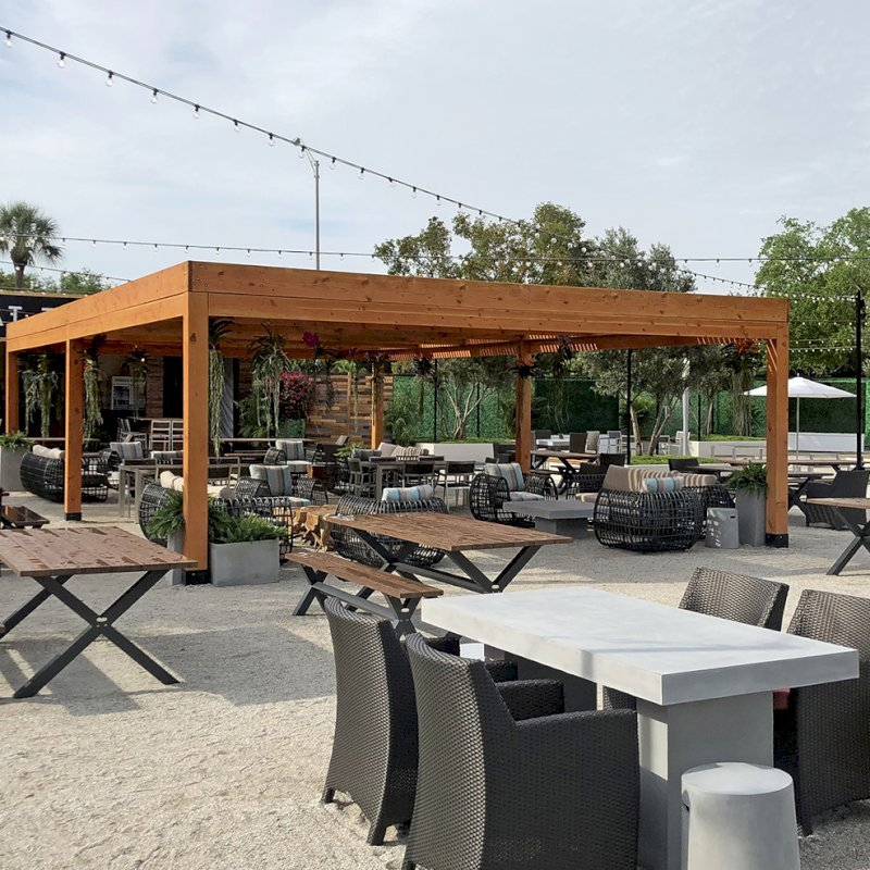 """Modern Louvered Garden Pergola (Options: 40' L x 24' W, 8"""" x 8"""" Posts, Mobile Louvers, Douglas-fir, 10 ft H, No Electrical Wiring Trim, 6-Post Anchor Kit for Hurricane, No post decorative trims, No Ceiling Fan Base, Transparent Premium Sealant). Photo Courtesy of the Miami Open at Dolphins Stadium in Miami, Florida."""