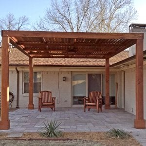 "Modern Louvered Garden Pergola (Options: 18' L x 14' W, 8"" x 8"" Posts, Mobile Louvers, Redwood, 9.5 ft H, Electrical Wiring Trim for 1 Post, 4 Post Anchor Kit for Concrete, No post decorative trims, With a Ceiling Fan Base, Transparent Premium Sealant). Photo Courtesy of F. Espinoza of Dallas, TX."