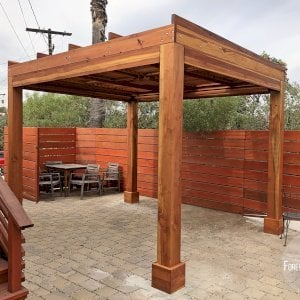 "Modern Louvered Garden Pergola (Options: 10' L x 12' W, 8"" x 8"" Posts, Mobile Louvers, Redwood, 9 ft H, Electrical Wiring Trim for 2 Posts, 4 Post Anchor Kit for Concrete, No post decorative trims, With a Ceiling Fan Base, Transparent Premium Sealant, 5 Slats with Slope on Top by Custom Request). Photo Courtesy of A. Carcieri of Los Angeles, CA."