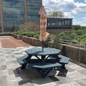 "Octagonal Picnic Table (Options: 5' Diameter Tabletop, Attached Benches, Douglas-fir, Standard Tabletop, Rounded Corners, 2"" Umbrella Hole, Custom Paint). Photo Courtesy of T. Dunne of Stamford, Connecticut."