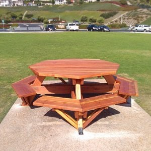 "Octagonal Picnic Table (Options: 5 1/2' Diameter Tabletop, Attached Benches, Redwood, Standard Tabletop, 1 5/8"" Umbrella Hole, Transparent Premium Sealant). Photo Courtesy of G. Cooley of Dana Point, CA."