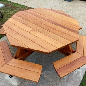"Octagonal Picnic Table (Options: 5' Diameter Tabletop, Attached Benches, Redwood, Standard Tabletop, 1 5/8"" Umbrella Hole, Transparent Premium Sealant). Photo Courtesy of G. Cooley of Dana Point, CA."